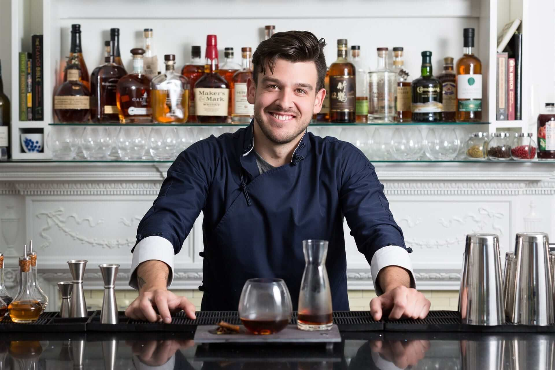 Photo of a Happy Mixologist at Natalie's Restaurant, One of the Best Bars in Camden Maine.