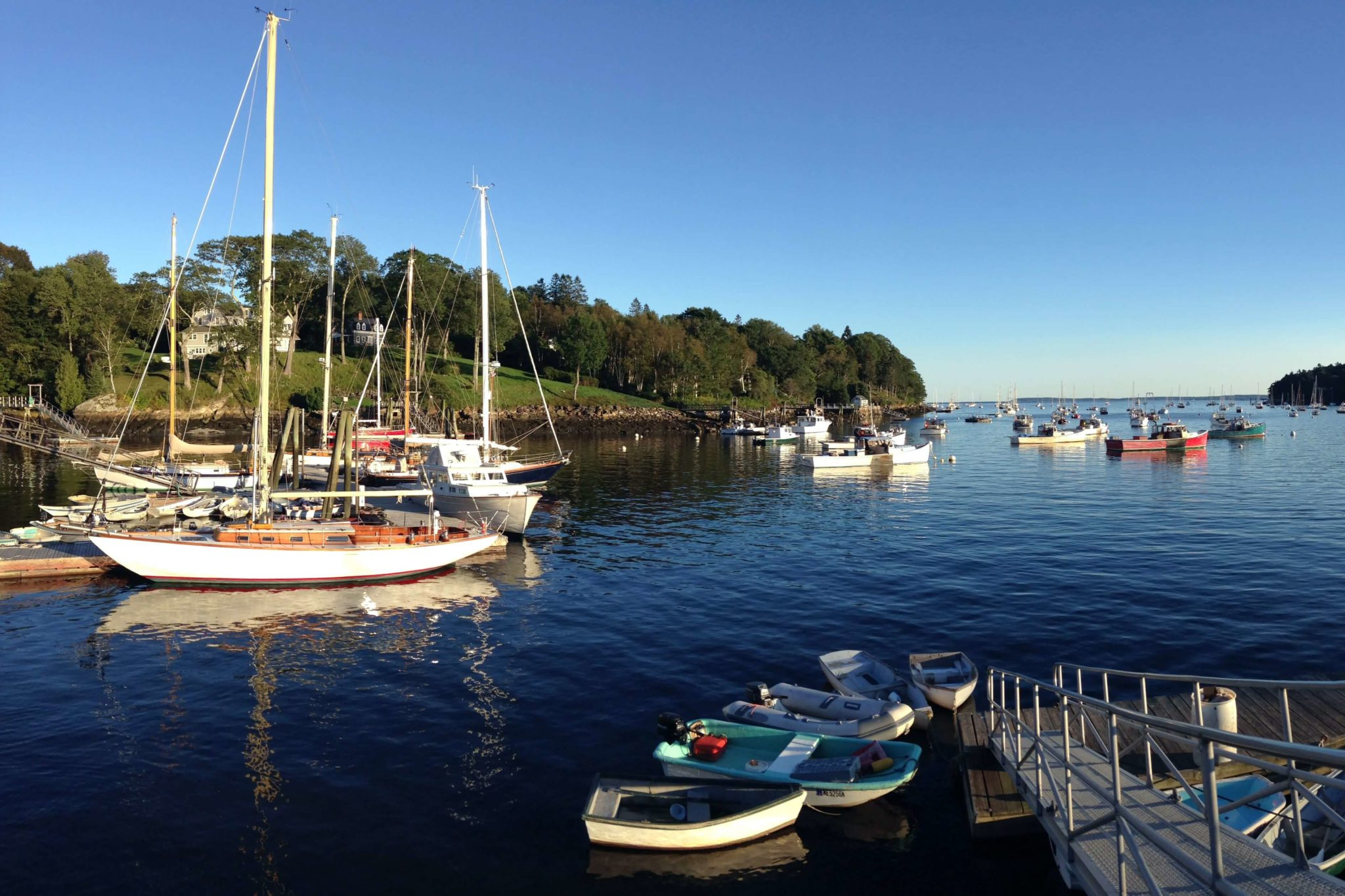 A photo of two boats on the water. Something you might see if you are interested in Camden, Maine sailing.